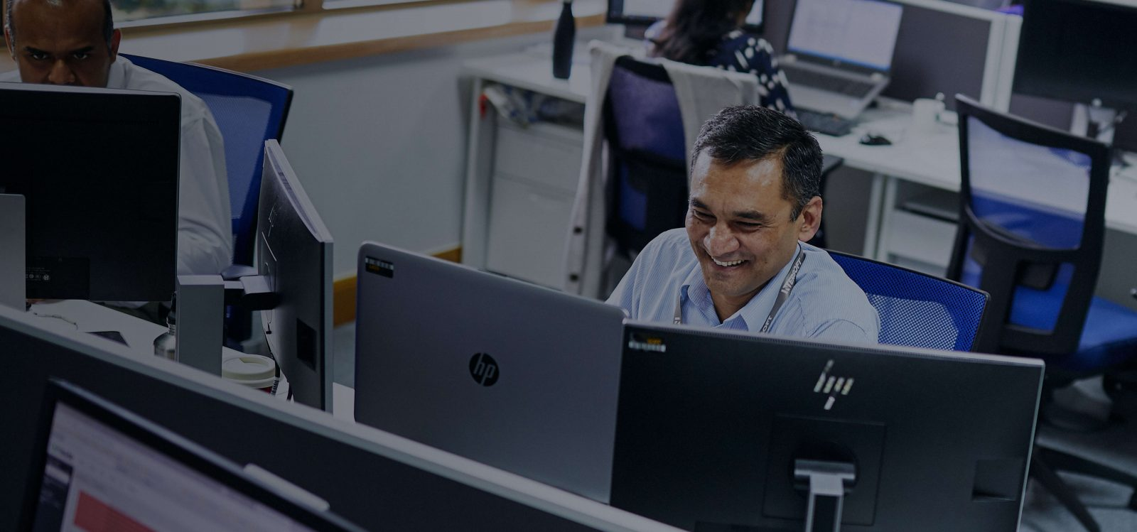 Happy man working at Intersoft